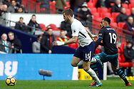 Eric Dier of Tottenham Hotspur (L) goes past Sofiane Boufal of Southampton (R). Premier league match, Tottenham Hotspur v Southampton at Wembley Stadium in London on Boxing Day Tuesday 26th December 2017.<br /> pic by Steffan Bowen, Andrew Orchard sports photography.