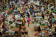 A girl is walking around a market on the island of Sao Tome, Sao Tome and Principe, (STP) a former Portuguese colony in the Gulf of Guinea, West Africa.