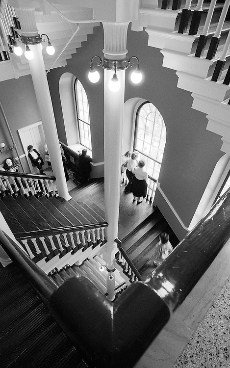 1993. Faneul Hall in Boston hosted some of the key patriot gatherings that led to the United States. I found this scene in the main staircase while touring Boston with a friend who lives there. I pressed myself against the wall to fill my wide-angle frame with the scene reminiscent of an M.C. Escher print. (B060593)