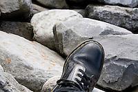 Worn doc martin boot on rocks