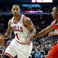04 May 2011: Chicago Bulls point guard Derrick Rose (1) drives past Atlanta Hawks guard Jeff Teague (0) during the Chicago Bulls 86-73 victory over the Atlanta Hawks, during game 2 of the Eastern Conference semi finals at the United Center, Chicago, Illinois, USA.