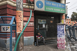 KOLKATA, Nov. 9, 2016 (Xinhua) -- An Indian man seats in front of a closed ATM in Kolkata, capital of eastern Indian state West Bengal, Nov. 9, 2016. India Tuesday night abolished currency notes of 500 and 1,000 denomination in one of the biggest revolutionary monetary reforms since independence, aimed at curbing the menace of black money. All ATMs and banks remain shut on Wednesday and Thursday. (Xinhua/Tumpa Mondal).****Authorized by ytfs* (Credit Image: © Tumpa Mondal/Xinhua via ZUMA Wire)