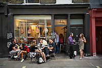 Photo of people outside Fernandez and Wells restaurant in London, England