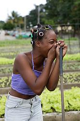 Woman laughing at work at Organiponico La Sazon urban farm; Havana; Cuba,