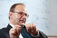 11 NOV 2010, POTSDAM/GERMANY:<br /> Prof. Ottmar Edenhofer, Deputy Director Potsdam Institute for Climate Impact Research, PIK, während einem Interview, in seinem Buero, Potsdam Institute for Climate Impact Research<br /> IMAGE: 20101111-03-011