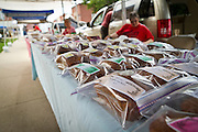 Row upon row of hand-crafted loaves of bread from Aldrich Produce sit on tables along 4th Street during Thursday's Farmers' Market in Grinnell, Iowa.