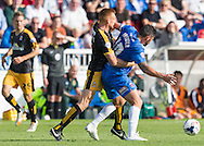 Billy Paynter (Hartlepool United) holds the ball from Mark Roberts (Cambridge United) during the Sky Bet League 2 match between Hartlepool United and Cambridge United at Victoria Park, Hartlepool, England on 19 September 2015. Photo by George Ledger.