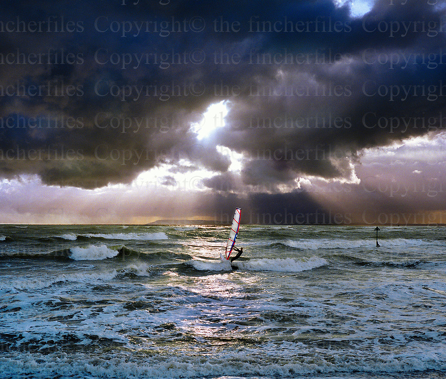 A windsurfer sails near the beach at West Wittering in West Sussex photographed by Terry Fincher.