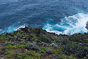 Rugged volcanic coastline and rocks at Playa de Nogales in La Palma, Canary Islands, Spain. La Palma, also San Miguel de La Palma, is the most north-westerly Canary Island in Spain. La Palma has an area of 706 km2 making it the fifth largest of the seven main Canary Islands.
