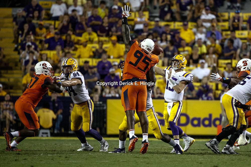 Sep 23, 2017; Baton Rouge, LA, USA; LSU Tigers quarterback Myles Brennan (15) throws past Syracuse Orange defensive lineman Chris Slayton (95) during the fourth quarter of a game at Tiger Stadium. LSU defeated Syracuse 35-26. Mandatory Credit: Derick E. Hingle-USA TODAY Sports