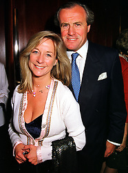 MR & MRS JUSTIN CADBURY at a reception in London on 14th October 1999.<br /> MXT 26
