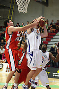 Pistons Alex Pledger blocks Saints Casey Frank's shot during their NBL Game at  Hamilton ,Basketball,Pistons Vs Saints , Wednesday 4 May 2011.<br /> Photo: Dion Mellow / photosport.co.nz