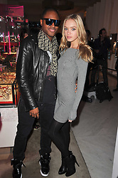 ROXANE HORNER and TAIO CRUZ at the launch of Project PEP to benefit the Elton John Aids Foundation hosted by Tamara Mellon and Diana Jenkins in association with Jimmy Choo held at Selfridges, Oxford Street, London on 29th October 2009.