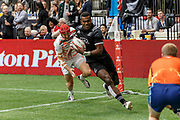 VANCOUVER, BC - MARCH 11: Joe Ravouvou (#4) of New Zealand outruns Richard de Carpentier (#1) of England to score during Game # 38- New Zealand vs England 5th Place SF 2 match at the Canada Sevens held March 10-11, 2018 in BC Place Stadium in Vancouver, BC. (Photo by Allan Hamilton/Icon Sportswire)