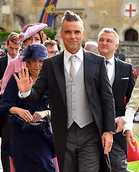Robbie Williams arrives for the wedding of Princess Eugenie to Jack Brooksbank at St George's Chapel in Windsor Castle