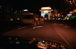 "Pyongyang, North Korea, April/May 2004. Pyongyang by night. In the back the ""Arc of Triumph""<br /> The Arc of Triumph was erected in 1982 'to glorify the Heroic Exploits of President Kim Il Sung who returned home in triumph after liberating the country'.<br /> The Arc is 60 meters high, just a bit bigger than the Arc de Triumph in Paris.  (Photo by Teun Voeten) *** Please Use Credit from Credit Field ***"