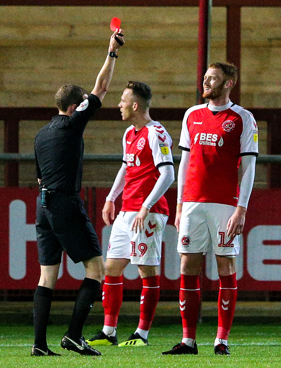 Referee Peter Wright shows Fleetwood Town's Cian Bolger the red card<br /> <br /> Photographer Alex Dodd/CameraSport<br /> <br /> The EFL Checkatrade Trophy - Northern Group B - Fleetwood Town v Leicester City U21 - Tuesday September 11th 2018 - Highbury Stadium - Fleetwood<br />  <br /> World Copyright © 2018 CameraSport. All rights reserved. 43 Linden Ave. Countesthorpe. Leicester. England. LE8 5PG - Tel: +44 (0) 116 277 4147 - admin@camerasport.com - www.camerasport.com