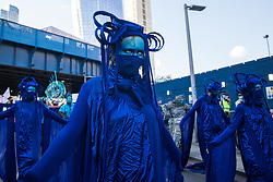 The blue rebels join fellow climate activists from the Ocean Rebellion and Extinction Rebellion at a colourful Marine Extinction March on 6 September 2020 in London, United Kingdom. The activists, who are attending a series of September Rebellion protests around the UK, are demanding environmental protections for the oceans and calling for an end to global governmental inaction to save the seas.