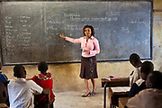 Madame Dora teaching Phase 3 at Mathare School in Nairobi, Kenya. Undugu Society of Kenya (USK), an NGO who run various programmes to help the school and children.