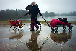 © London News Pictures. 07/03/2013. Birmingham, UK. Dogs and their owners arriving in the rain for day one of Crufts at the Birmingham NEC Arena on March, 07, 2013 in Birmingham, England.  Crufts, which is the largest annual dog show in the world, hosts over 20,000 dogs and owners who compete in a variety of categories. Photo credit : Ben Cawthra/LNP