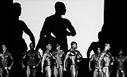 """BODYBUILDING<br /> I covered the Australian Bodybuilding Championships for a couple of years .Initially I was intrigued by these people who undertook extreme exercise,diet and weight regimes to sculpt their bodies way beyond that of the average human body. From day one my first thought , after a fleeting feeling of intimidation on being surrounded by these massive frames, was that these bodybuilders were extremely dedicated and driven athletes.<br /> <br /> Date..20th October 2007<br /> Pixs taken during the """"2007 AUSTRALIAN BODYBUILDING CHAMPIONSHIPS """" at Revesby Workers Club , (3 Brett Street Revesby).which also incorporated BODYSHAPING, FITNESS and FIGURE..<br /> <br /> Images were taken down in the so called """"PIT"""" where competitors got ready , pumped themselves up and rubbed fake body tan on etc. There are also pixs of competitors in the small makeup rooms just off to the side of the stage where they check themselves out, practice their poses, and make final adjustments before going onto the stage to compete.Finally there are pixs of them on stage .The event was a PAUL and CAROL GRAHAM Production."""