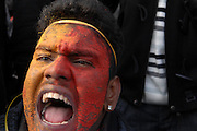 A young man, his face painted in the colours of the Tamil Flag, calls for reporters to be allowed access in Sri Lanka