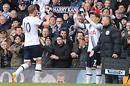 a young Spurs fans holds up a Harry Kane scarf as his hero Harry Kane of Tottenham Hotspur is replaced by Son Heung-Min . Barclays Premier league match, Tottenham Hotspur v Manchester Utd at White Hart Lane in London on Sunday 10th April 2016.<br /> pic by John Patrick Fletcher, Andrew Orchard sports photography.