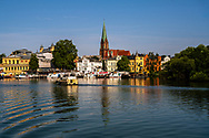 Schwerin Germany--July 25, 2019.  A colorful landscape photo of the town of Schwerin and a marina on a beautiful summer morning.