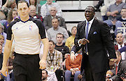 Utah Jazz head coach Tyrone Corbin, right, reacts after being charged with a technical foul by official Marat Kogut, left, during the second half of an NBA basketball game, Saturday, Jan. 21, 2012, in Salt Lake City. (AP Photo/Colin E Braley).