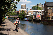 Woman cycling along the Hertfordshire Canal in East London. The Hertford Union Canal or Duckett's Canal is a short stretch (c. 1.5 km) of canal in the London Borough of Tower Hamlets. It connects the Regent's Canal to the Lee Navigation. It was opened in 1830.
