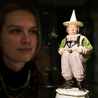 LONDON, ENGLAND - NOVEMBER 24: Nette Megens, a Bonhams porcelain specialist, poses with a Meissen figure of the Court Jester Joseph Frolich circa 1752 on November 24, 2009 in London, England. Bonhams will hold three separatee sales for the Hoffmaister Collection of Meissen porcelains, the first will be on November 25, 2009<br /> <br /> <br /> ***Agreed Fee's Apply To All Image Use***<br /> Marco Secchi /Xianpix<br />  tel +44 (0) 771 7298571<br />  e-mail ms@msecchi.com <br /> www.marcosecchi.com