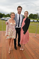 Left to right, ELSA PATAKY,CHRIS HEMSWORTH and EMILY BLUNT at the Audi Polo Challenge at Coworth Park, Blacknest Road, Ascot, Berkshire on 31st May 2015.