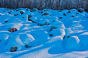 Snow and ice on rocks on the shore of Lake Winnipeg<br /> VIctoria Beach<br /> Manitoba<br /> Canada