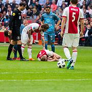 NLD/Amsterdam/20180408 - Ajax - Heracles, Matthijs de Ligt (4) geblesseerd oip de grond