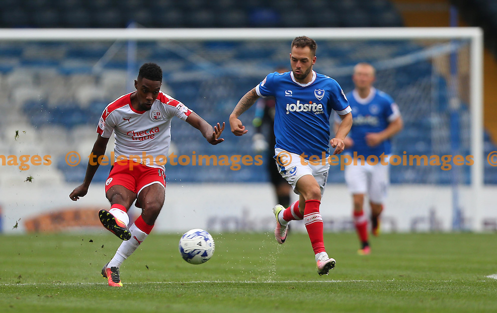 Crawley's Jason Banton passes  forward during the Sky Bet League 2 match between Portsmouth and Crawley Town at Fratton Park in Portsmouth. September 3, 2016.<br /> James Boardman / Telephoto Images<br /> +44 7967 642437