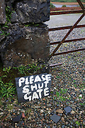 Gate and sign detail at Kinlochspelve Church House by Thomas Telford on Isle of Mull, Scotland.