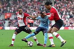 15 October 2017 - Premier League Football - Southampton v Newcastle United - Ayoze Perez of Newcastle pulls the shirt of Virgil van Dijk of Southampton as they battle for the ball with Nathan Redmond of Southampton - Photo: Charlotte Wilson / Offside
