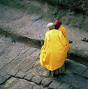 Priests embracing at Lalibela, Ethiopia.