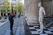 "Ecce Homo - Kate Allen, Director of Amnesty International UK, helped by Canon Mark Oakley (Chancellor of St Paul's Cathedral), installs Mark Wallinger's 'Ecce Homo' statue at St Paul's Cathedral. The life-size sculpture shows the figure of Jesus Christ and was the first artwork to be shown on Trafalgar Square's fourth plinth in 1999.Mark Wallinger, who won the Turner Prize in 2007, said: ""This vulnerable figure will stand at the top of the steps outside the entrance to St Paul's Cathedral as we approach Easter to highlight the plight of people around the world who are imprisoned and whose lives are threatened for speaking the truth, and for what they believe."""