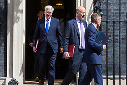 London, July 18th 2017. In a clear demonstration of unity with a cabinet that has seemed to be split over Brexit and other issues,  Government ministers, L-R Defence Secretary Michael Fallon, Transport Secretary Chris Grayling and Chief Whip (Parliamentary Secretary to the Treasury) Gavin Williamson leave the last cabinet meeting together before the Parliamentary summer recess at Downing Street in London.