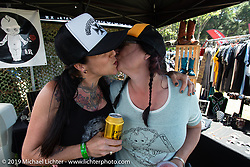 Heyltje and Jacole in Heyltje's jewelry vendor booth at the Born Free chopper show. Silverado, CA. USA. Sunday June 24, 2018. Photography ©2018 Michael Lichter.