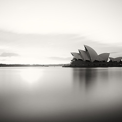 A smooth Black and White version of Sydney Harbour featuring the Opera House.
