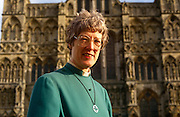 "A portrait of Britain's first lady deacon, Christine Farrington at Salisbury Cathedral. Standing outside the grand architecture of this fine English structure. Deacon is a ministry in the Christian Church that is generally associated with service of some kind, but which varies among theological and denominational traditions. In many traditions the ""diaconate"", the term for a deacon's office, is a clerical office; in others it is for laity. The word ""deacon"" is derived from the Greek word diakonos, standard ancient Greek for ""servant"", ""waiting-man"", ""minister"" or ""messenger"". Salisbury Cathedral, formally known as the Cathedral Church of the Blessed Virgin Mary, is an Anglican cathedral in Salisbury, England, and is considered one of the leading examples of Early English architecture. The main body was completed in only 38 years, from 1220 to 1258."