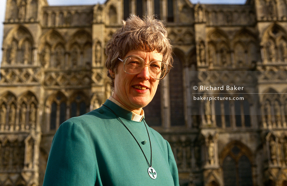 """A portrait of Britain's first lady deacon, Christine Farrington at Salisbury Cathedral. Standing outside the grand architecture of this fine English structure. Deacon is a ministry in the Christian Church that is generally associated with service of some kind, but which varies among theological and denominational traditions. In many traditions the """"diaconate"""", the term for a deacon's office, is a clerical office; in others it is for laity. The word """"deacon"""" is derived from the Greek word diakonos, standard ancient Greek for """"servant"""", """"waiting-man"""", """"minister"""" or """"messenger"""". Salisbury Cathedral, formally known as the Cathedral Church of the Blessed Virgin Mary, is an Anglican cathedral in Salisbury, England, and is considered one of the leading examples of Early English architecture. The main body was completed in only 38 years, from 1220 to 1258."""