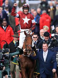Jockey Davy Russell celebrates winning the Ryanair Steeple Chase with horse Balko Des Flos during St Patrick's Thursday of the 2018 Cheltenham Festival at Cheltenham Racecourse.