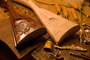 Two hand made guns sit on a workshop table in gun and guitar maker Bobby Denton's shop in Morganton, North Carolina