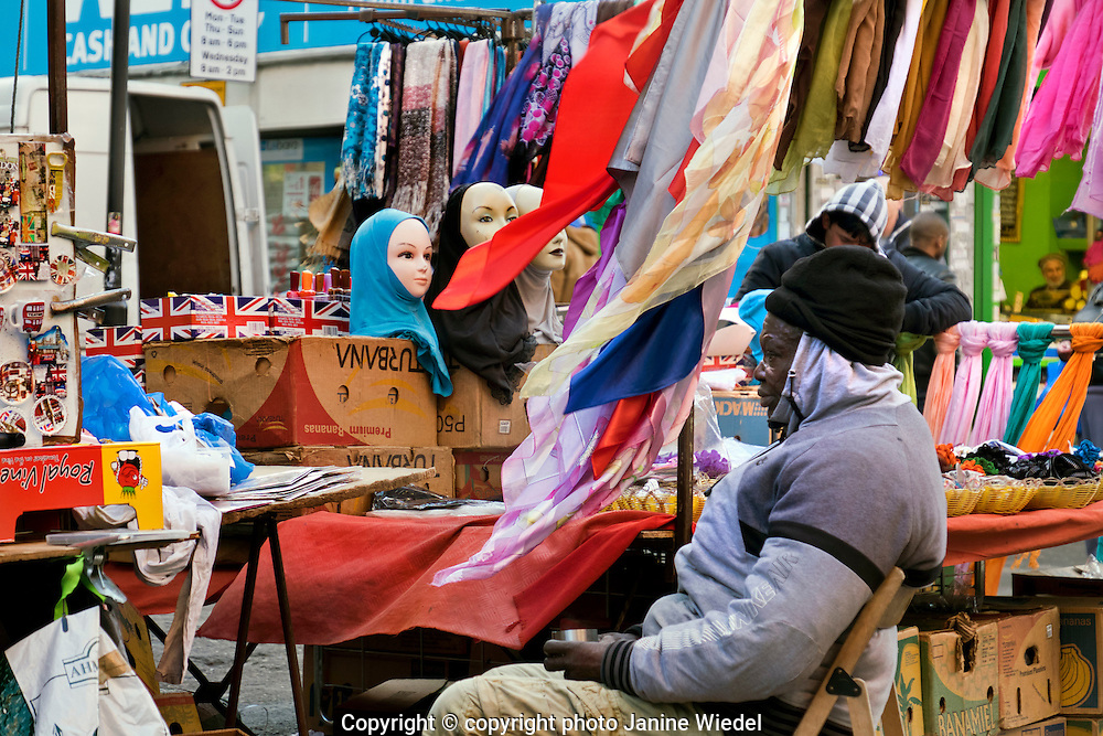 Market stall selling scarves and trinkets  Brixton South London