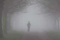 © Licensed to London News Pictures. 30/12/2016. Southsea, UK.  A woman jogging through the thick fog on Southsea Common. People on the South Coast have woken up to foggy weather this morning, 30th December 2016. Photo credit: Rob Arnold/LNP