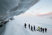 UNIS professor Doug Benn (yellow) and his students approach exposed glacier ice on Tellbreen, Svalbard.