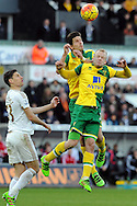 Norwich's Timm Klose (highest) and Steven Naismith challenge each other for a header. Barclays Premier league match, Swansea city v Norwich city at the Liberty Stadium in Swansea, South Wales on Saturday 5th March 2016.<br /> pic by  Carl Robertson, Andrew Orchard sports photography.